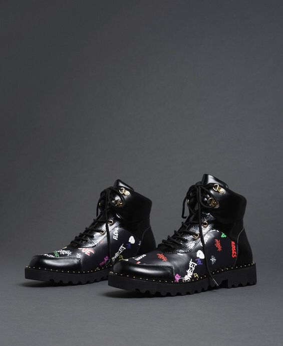 Faux leather combat boots with graffiti print