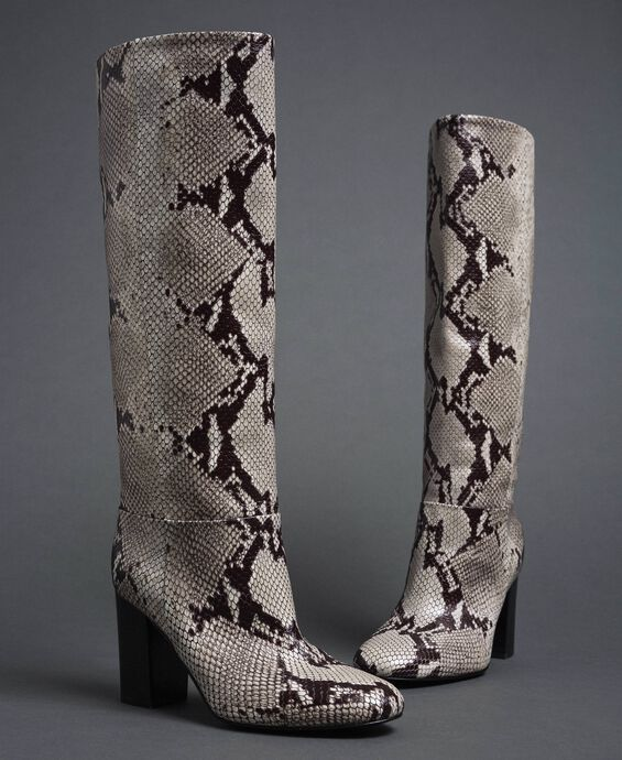 Leather boots with animal print