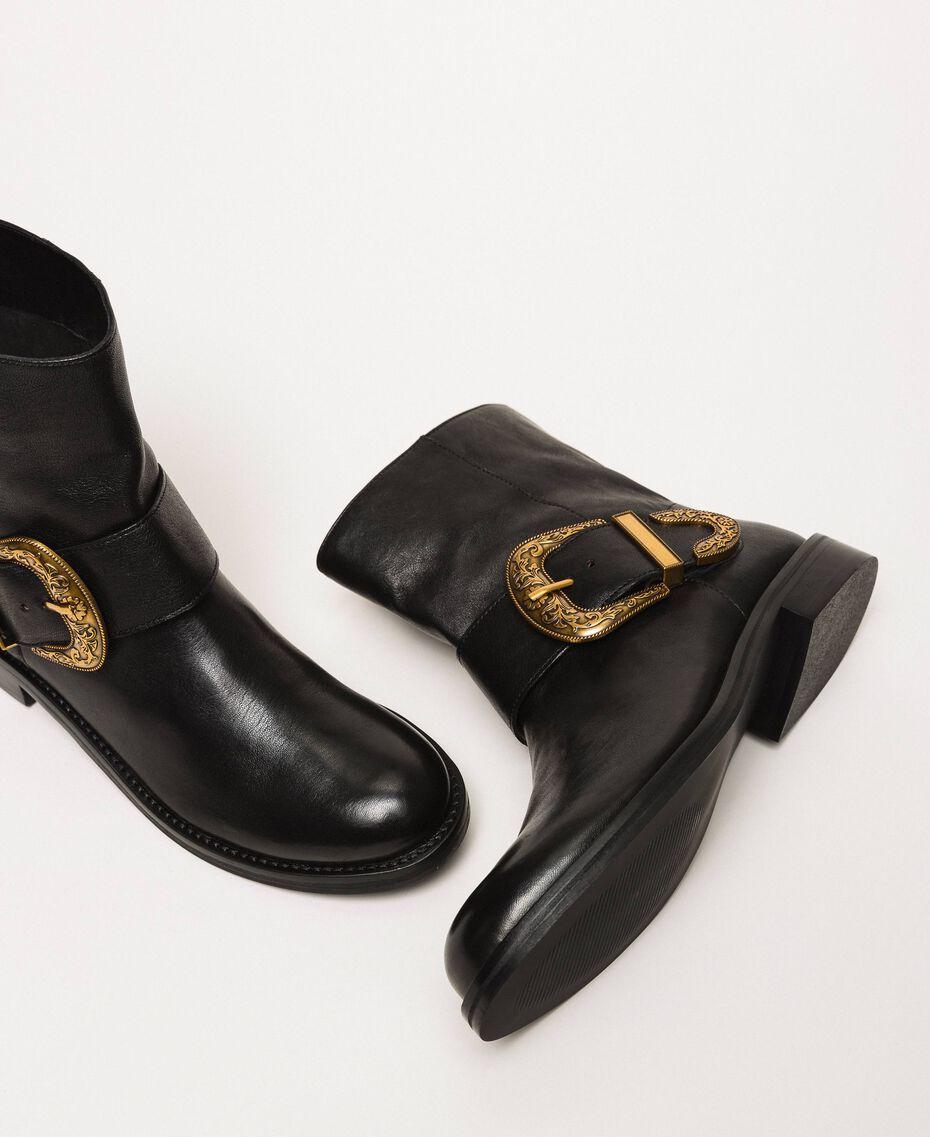 Кожаные байкерские сапоги с крупной пряжкой Черный женщина 201TCP058-02