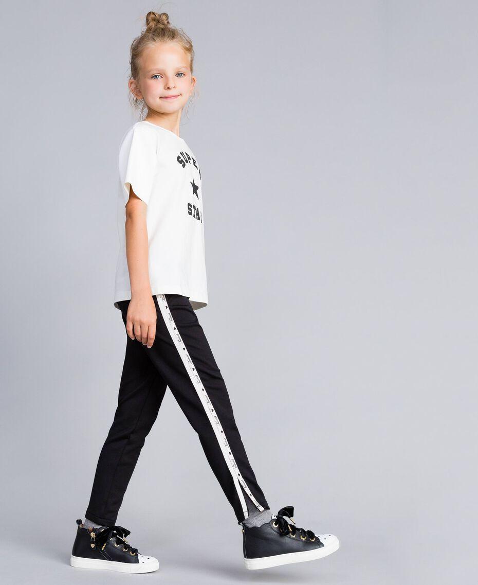 """Leggings aus technischem Stoff mit Logo Zweifarbig Schwarz / """"Blush""""-Rosa Kind GA82PR-02"""