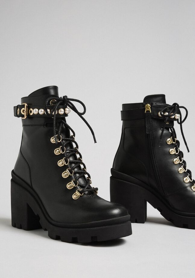 Leather combat boots with heel and pearls