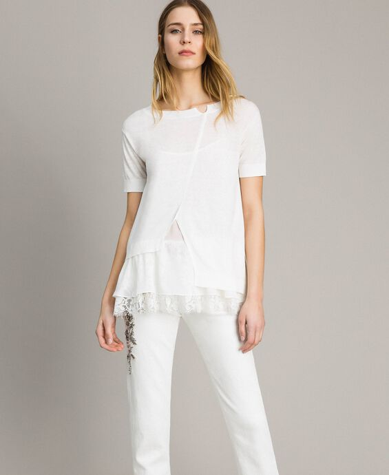 Asymmetric linen blend top with flounce