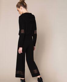 Pantaloni in maglia con pizzo Nero Donna 201LL3GBB-03