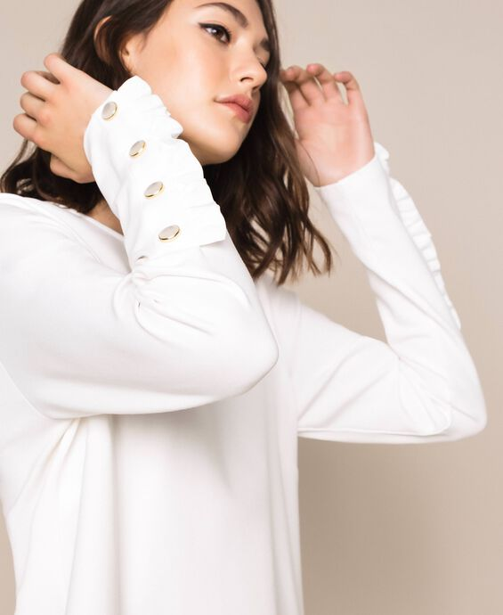Blouse with frill and pearls
