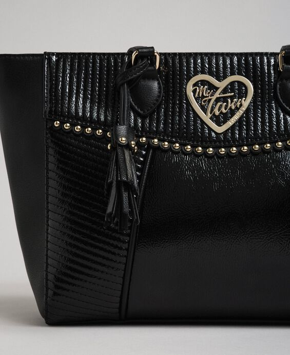 Faux leather shopping bag with studs and tassel