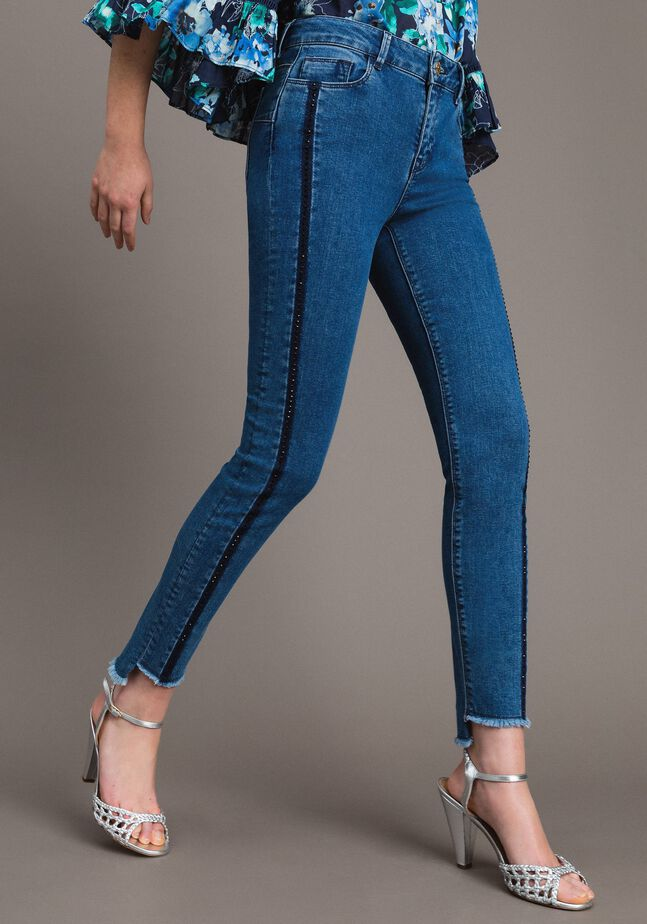 Skinny jeans with panels and rhinestones