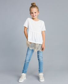 Skinny jeans with stones and rhinestones Light Denim Child GA82VN-0T