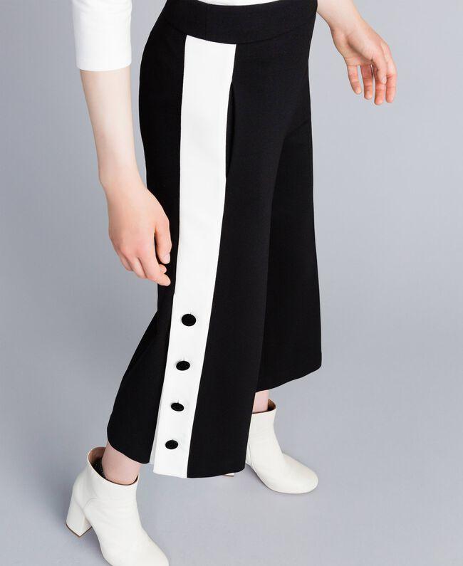 Cropped-Hose aus Interlock-Jersey Zweifarbig Schwarz / Schneeweiß Frau PA821P-04