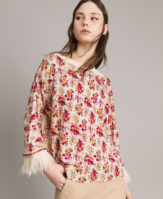 Pull-cardigan floral avec plumes et strass