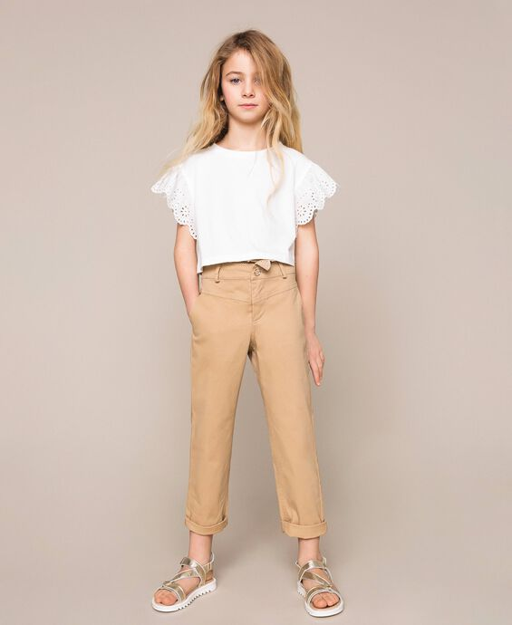 Trousers with broderie anglaise embroidery