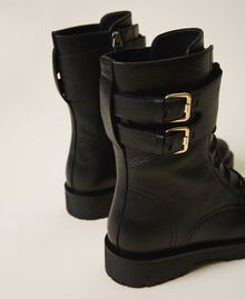 Combat boots with double buckle Black Woman 202TCT112-04