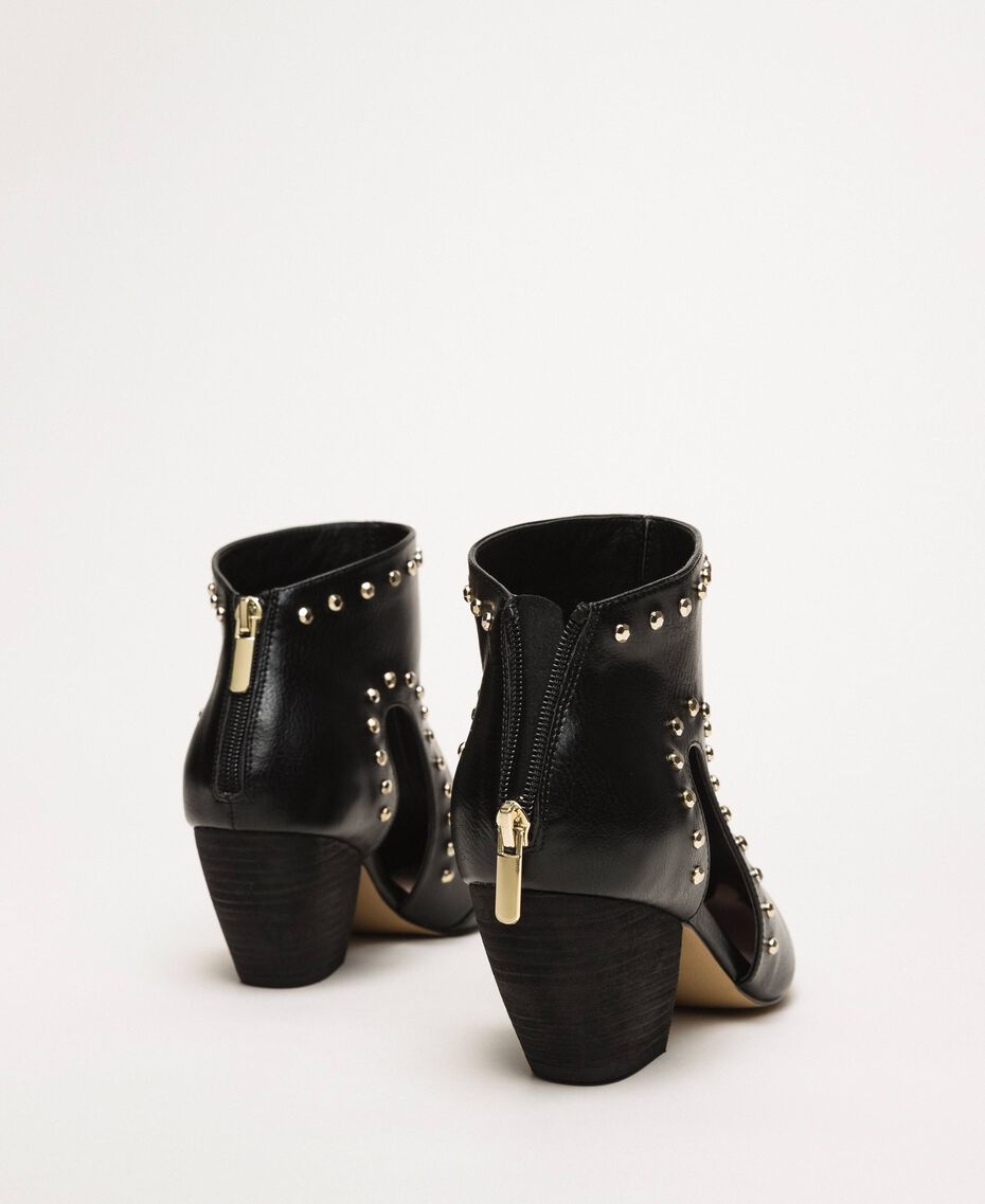Ankle boots with cutout and studs Black Woman 201MCP080-02