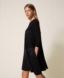 Kleid mit Nieten und Strass Schwarz Frau 202MT2152-01