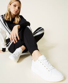 Leather trainers with rhinestone logo White Woman 212TCP140-0S