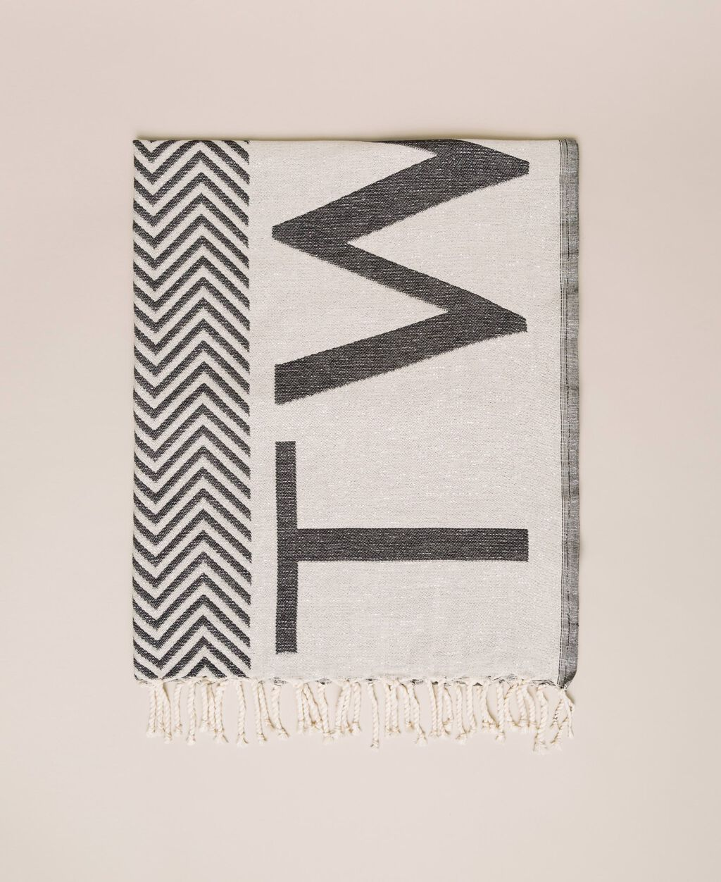 Jacquard beach towel with chevron motif