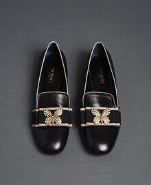 Loafer aus Leder mit besticktem Band Schwarz Frau 192TCP12G-04