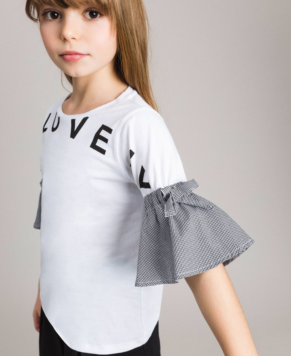 T-Shirt aus Jerseystoff mit Gingham-Volants Zweifarbig Optisch Weiß / Gingham Kind 191GJ2731-0S