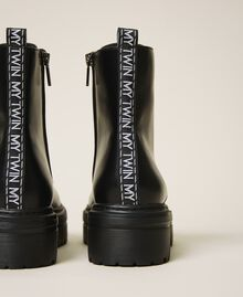 Faux leather combat boots with logo Black Woman 202MCP080-02