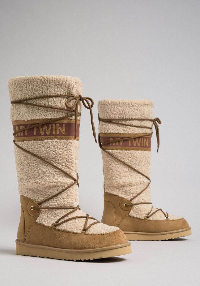 Faux fur boots with tie-up laces and logo
