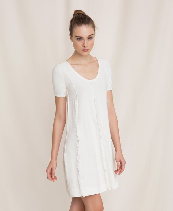 Dress with stitching and frills