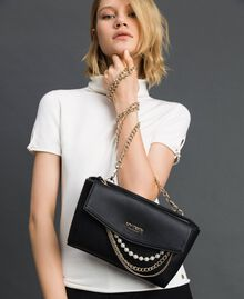 Faux leather shoulder bag with pearls and chains Black Woman 192MA7052-0S