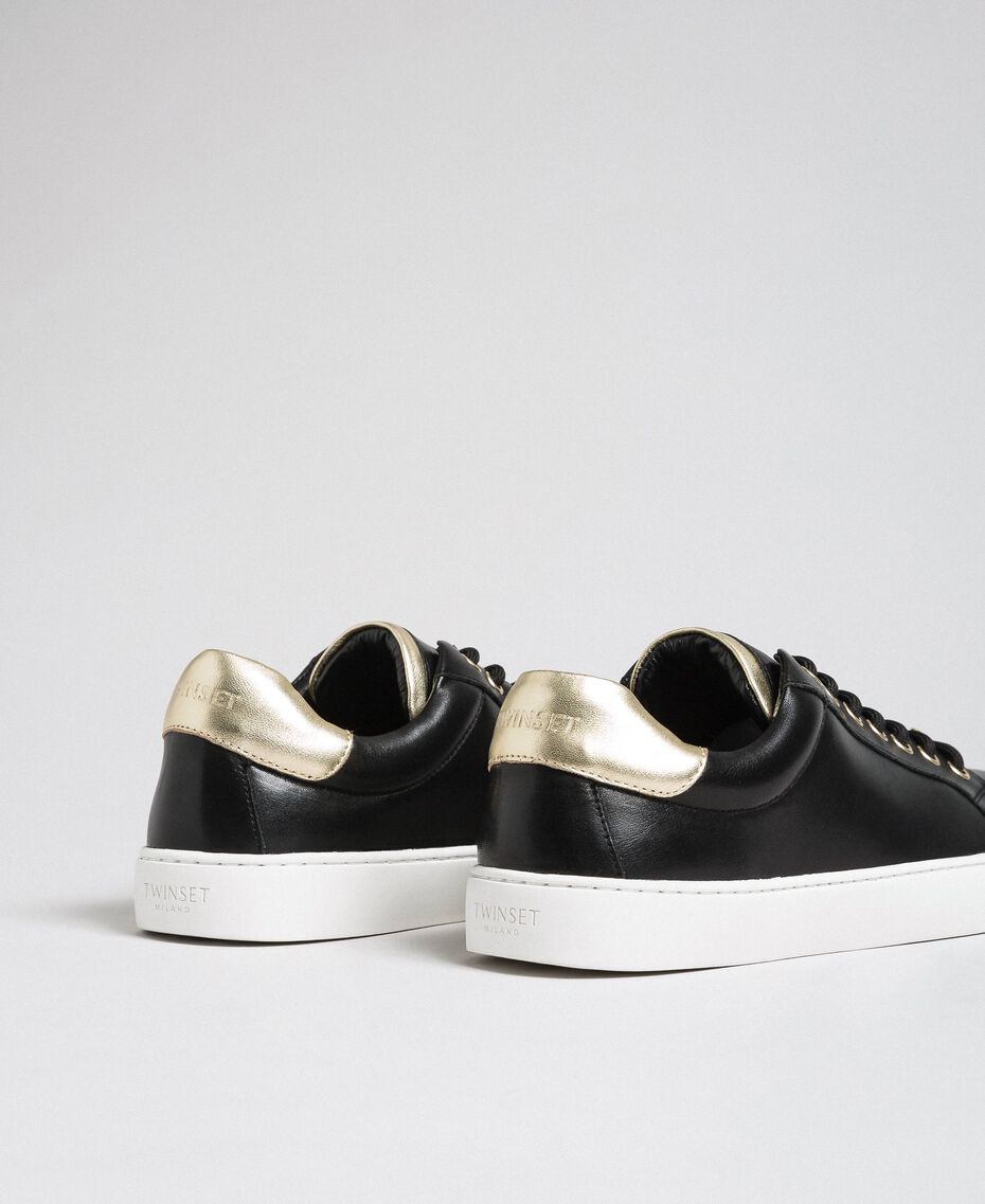 Leather trainers with contrasting details Black Woman 192TCP06E-02