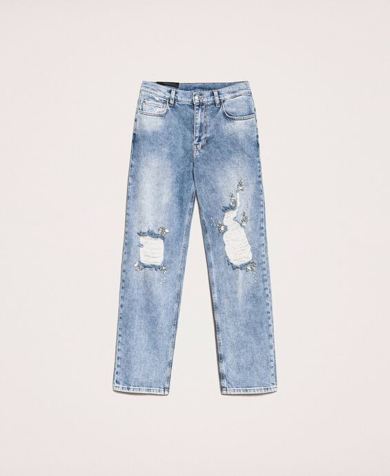 Jeans with rips and embroideries