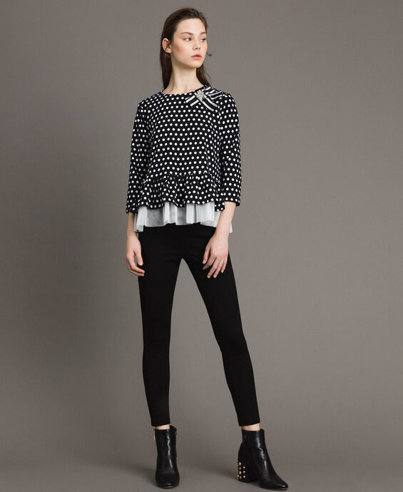 Bow shaped brooch polka dot blouse