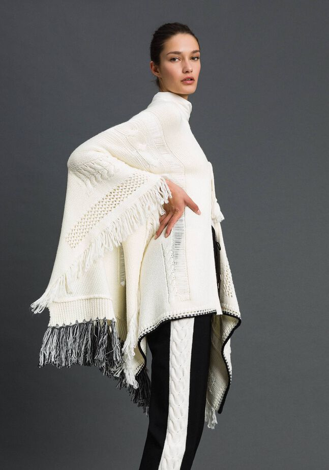 Openwork poncho with fringes and tassels