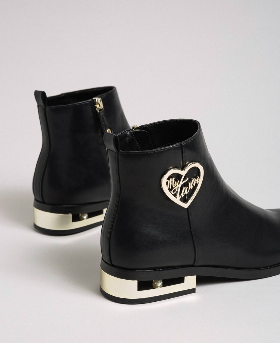 Logo ankle boots with decorative heel Black Woman 192MCP024-02