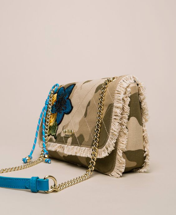 Canvas shoulder bag with patch and fringes