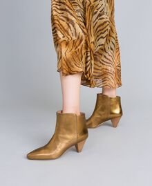 Laminated leather ankle boots Gold Yellow Woman CA8TPA-0S