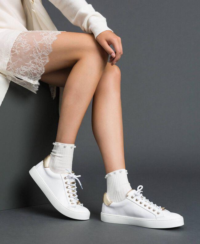 Sneakers aus Leder mit Kontrastdetail Schwarz Frau 192TCP06E-0S