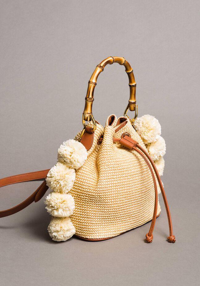 Straw bucket bag with pompom