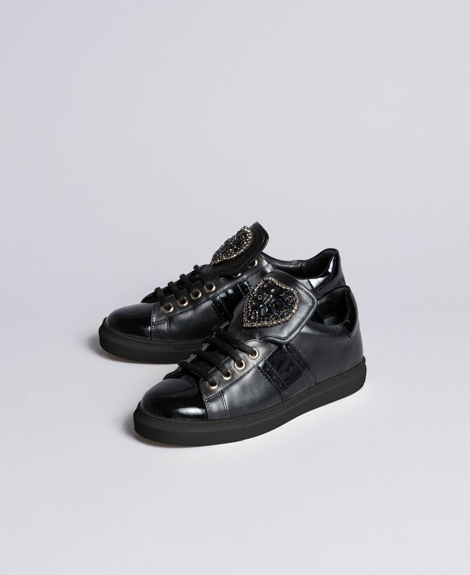Sneakers aus Leder mit Herzaufnäher Schwarz Frau CA8PB1-02