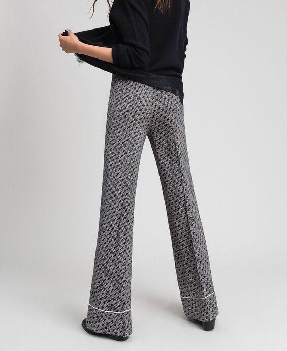 Pantalon palazzo avec imprimé siglé