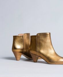 Laminated leather ankle boots Gold Yellow Woman CA8TPA-03