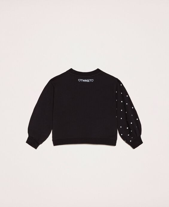 Sweatshirt with polka dots and sequin patch