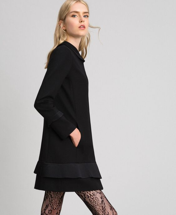 Coat with pleated detail