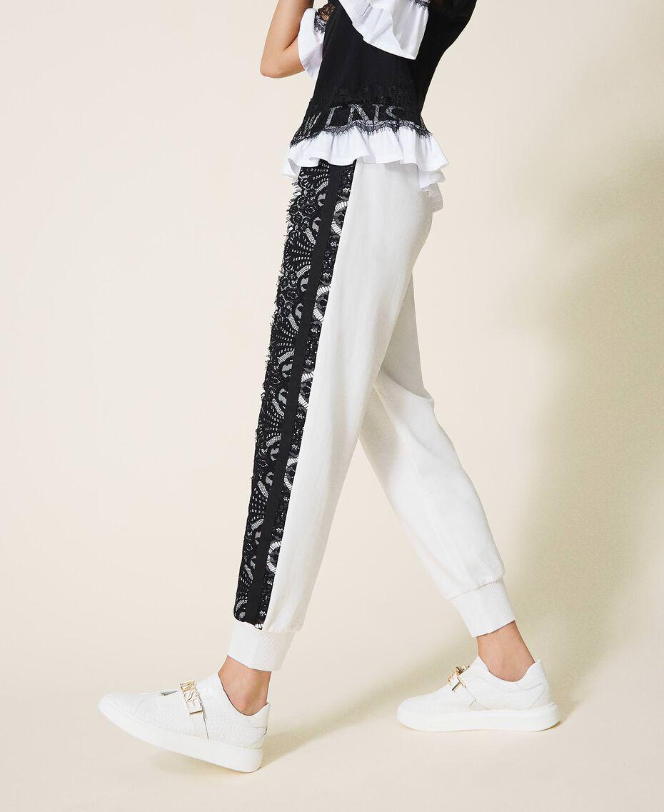 Joggers with logo and lace White Woman 202LI2NKK-02