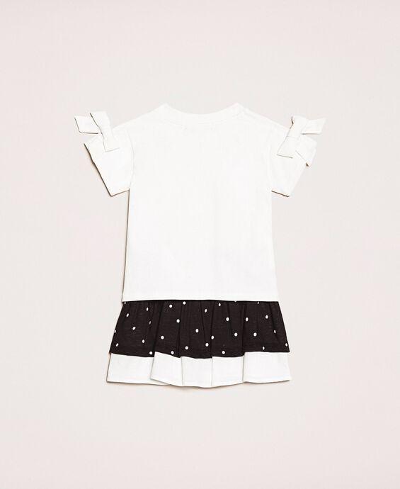 T-shirt with bows and polka dot skirt