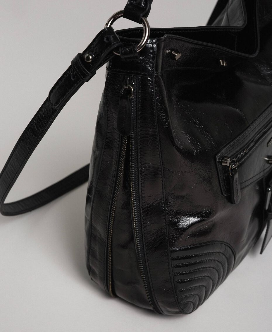 Hobo-Bag aus Leder in Craquelé-Optik mit Nieten Schwarz Frau 192TA7236-03