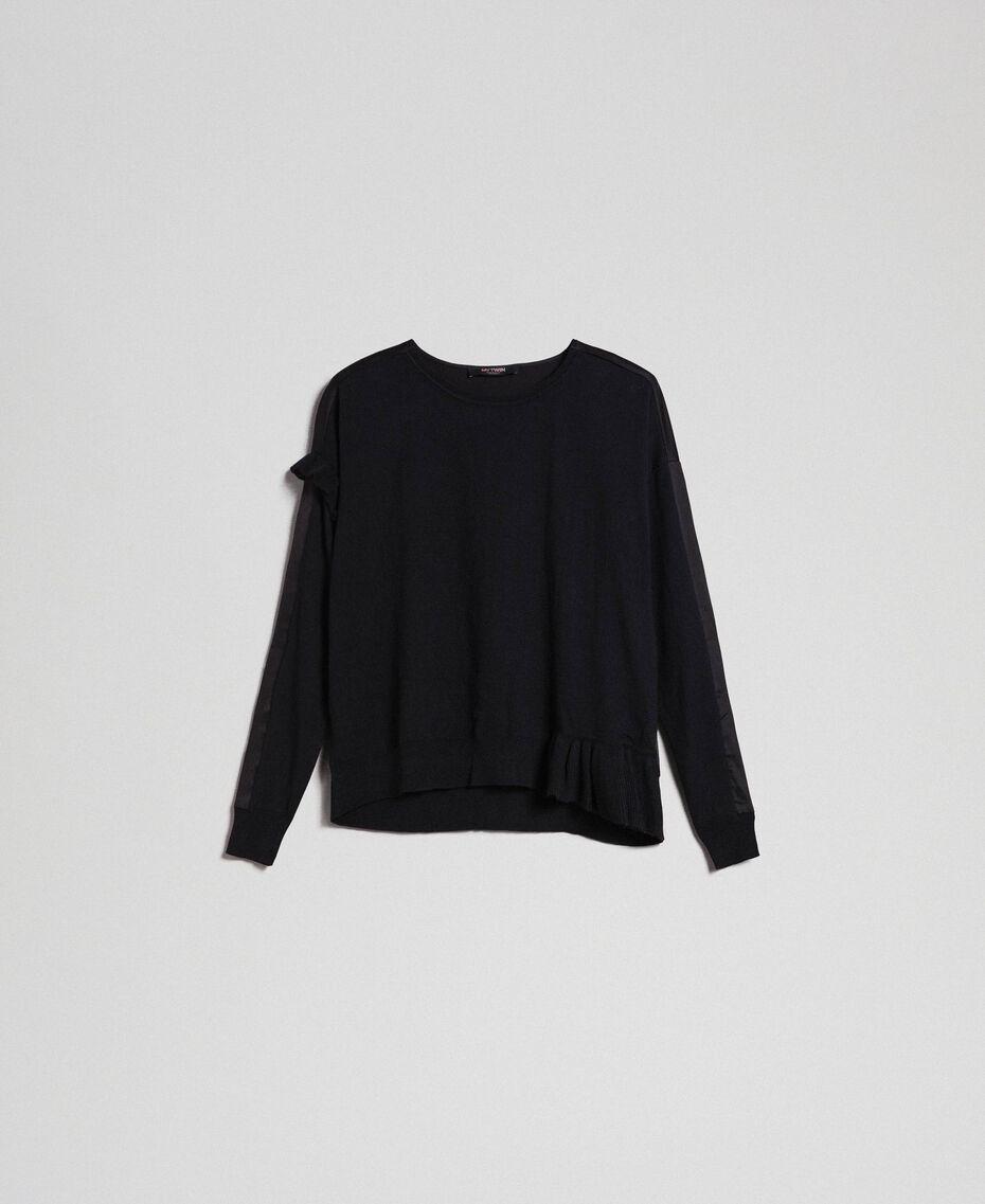 Kastiger Pullover mit asymmetrischen Volants Schwarz Frau 192MP3193-0S