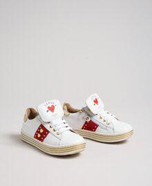 Sneakers in pelle con cuori e borchie Bianco Bambina 192GCJ012-02