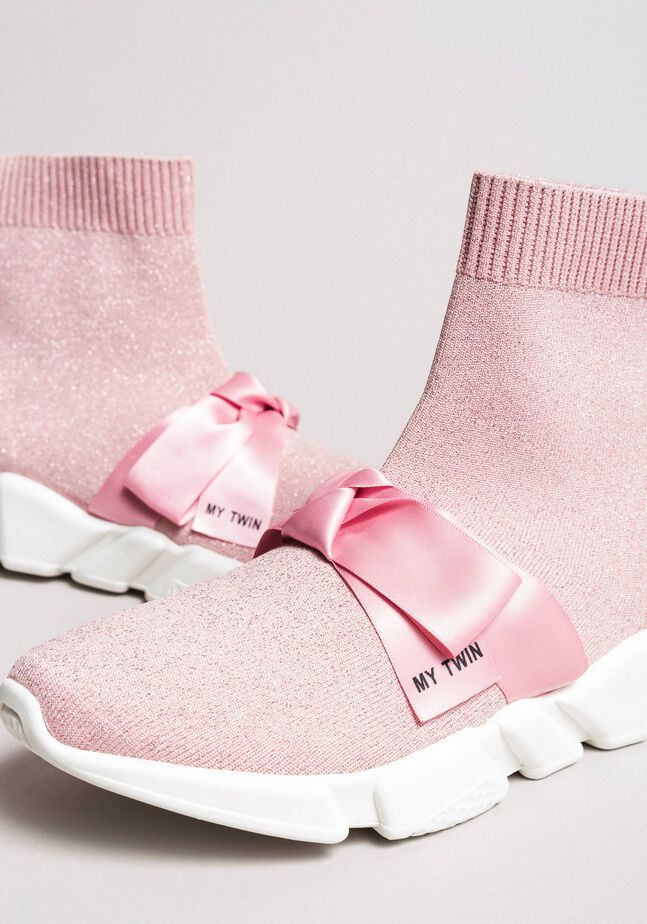 Running shoes with satin bow
