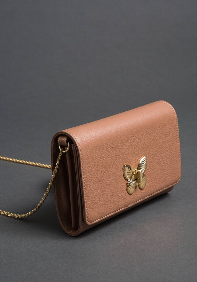Small shoulder bag with butterfly shaped turn lock