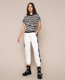 "Two-tone striped jumper with flower Black / ""Snow"" White Stripes Woman 201TP3221-01"