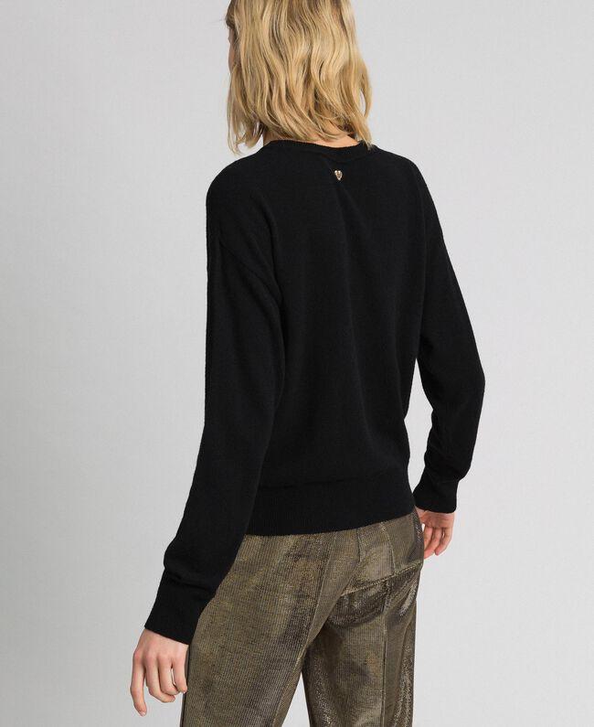 Pullover mit Jacquardintarsie und Logo aus Lurex Schwarz / Safrangelb Frau 192MP3081-03