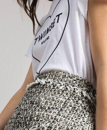 """Minijupe en tweed avec franges Bicolore Bouclé Blanc """"Neige"""" / Noir Femme 191TP2527-04"""