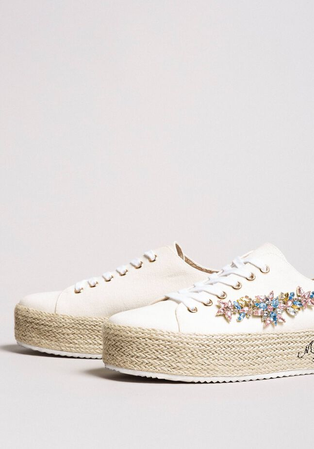 Sneakers with stones appliqué and logo